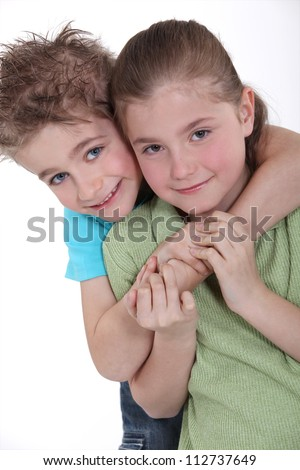 little boy and girl embracing - stock photo