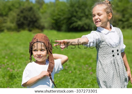Little boy and girl playing in the park. Brother and sister. Series of images.