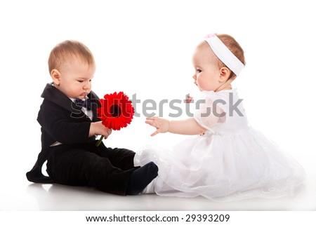 little boy and girl playing wedding - stock photo