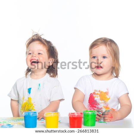 Little boy and girl playing with paints