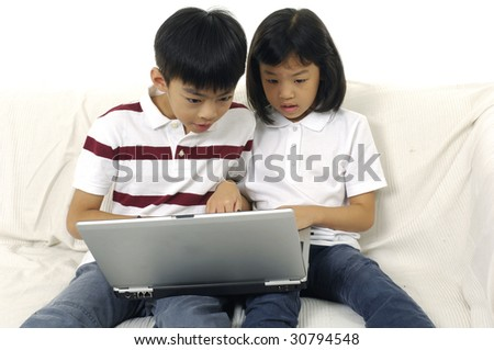 Little boy and girl portrait sitting at notebook