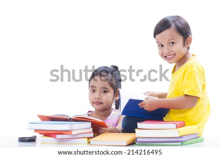 Little boy and girl reading books - stock photo