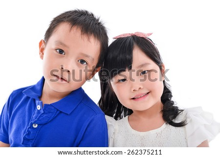little boy and girl standing isolated  - stock photo