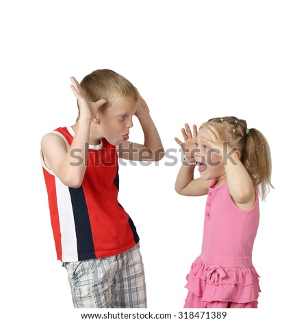 Little boy and girl teasing each other isolated on square white background