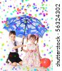 little boy and girl with umbrella under color rain - stock photo