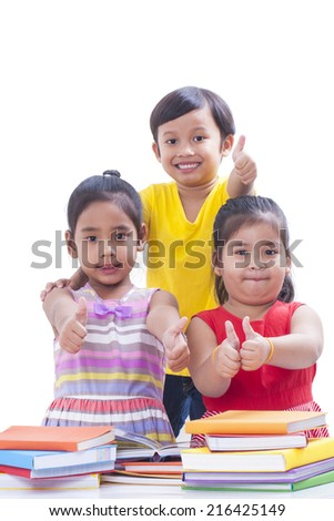 Little boy and girls reading book and showing thumbs up. - stock photo