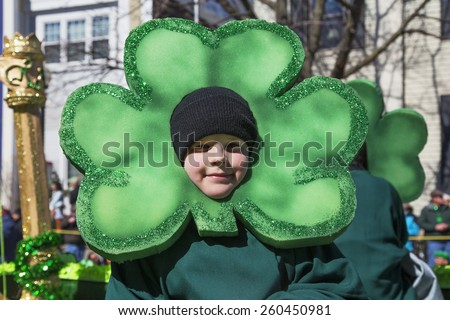Little boy and green cloverleaf, St. Patrick's Day Parade, 2014, South Boston, Massachusetts, USA, 03.16.2014 - stock photo