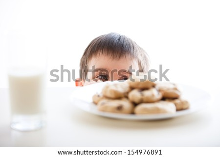 Little Boy And His Cookies - stock photo