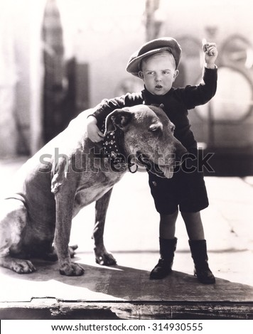 Little boy and his dog - stock photo
