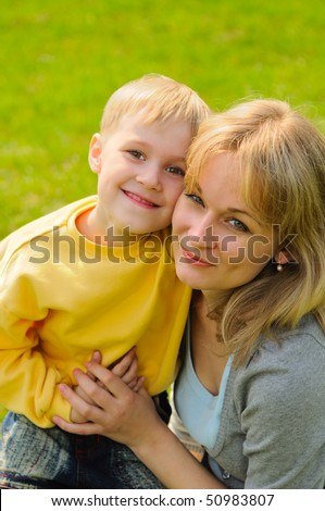 Little boy and his mother outdoor - stock photo