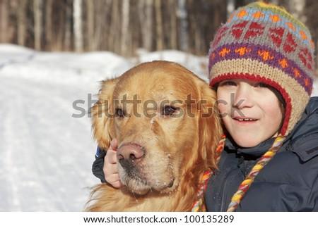 Little boy and his reliable friend dog together