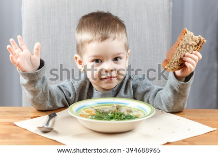 Little boy and his soup for dinner