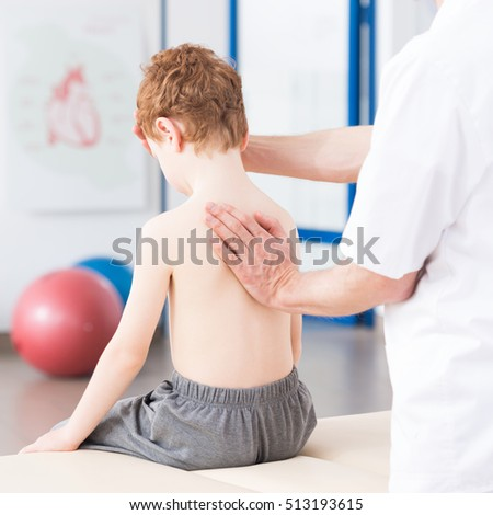Little boy and physiotherapist repairing bad posture habits
