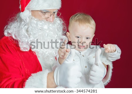 Little boy and Santa Claus at Christmas holiday. Concept of traditional world celebration, family holiday. New Year. Your dad dressed in a Santa Claus costume!