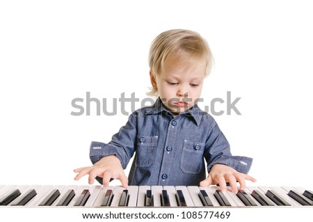 little boy and the keyboard on white background - stock photo