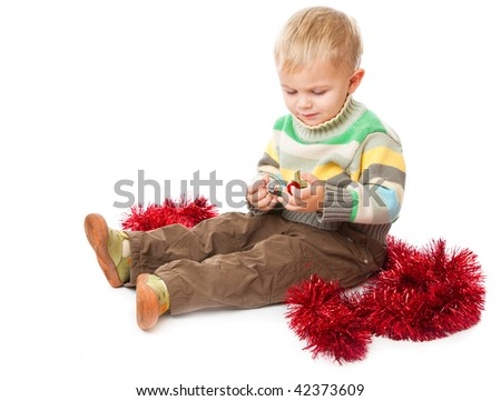 Little boy and tinsel Isolated on white background