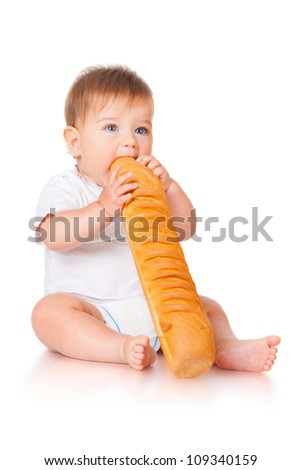 Little boy and with bread - stock photo