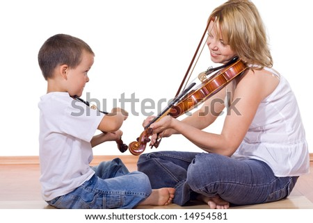 Little boy and woman sitting on the floor practicing the violin - isolated - stock photo