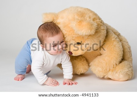 Little boy and yellow bear on white - stock photo