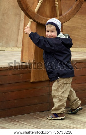 Little Boy As A Captain On A Boat - stock photo