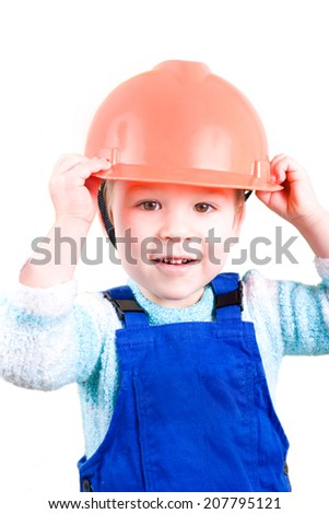 Little boy as a construction worker with helmet - stock photo