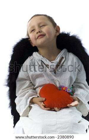 little boy as angel with black wings and heart - stock photo
