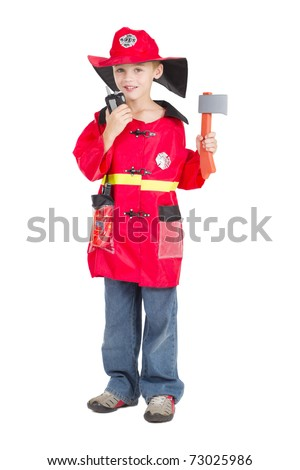little boy as fireman with walkie talkie and axe - stock photo