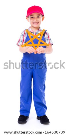 Little boy as handyman showing star made of wooden measuring ruler