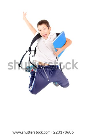 little boy at school jumping isolated in white - stock photo