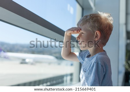 little boy at the airport - stock photo