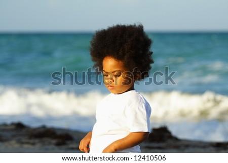 Little boy at the beach - stock photo