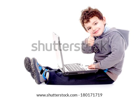 little boy at the computer isolated in white - stock photo