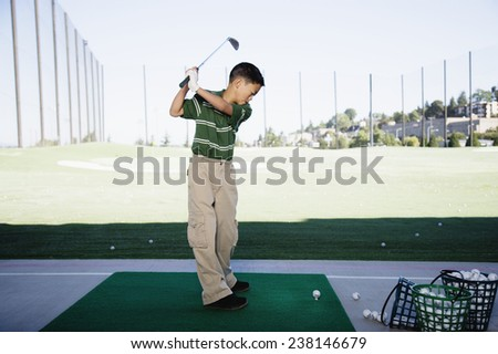 Little Boy at the Driving Range - stock photo