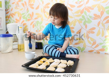 little boy bakes at home kitchen - stock photo