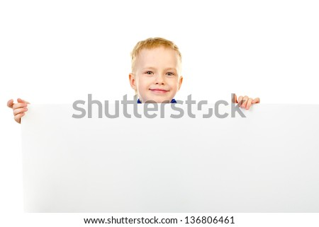little boy behind a white board