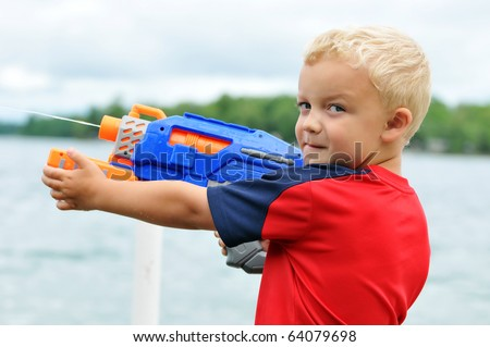 Little Boy Big Squirt Gun - stock photo