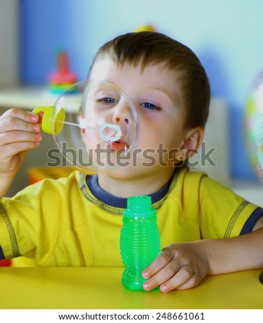 little boy blow bubbles - stock photo