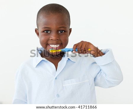 Little boy brushing his teeth in the bathroom - stock photo