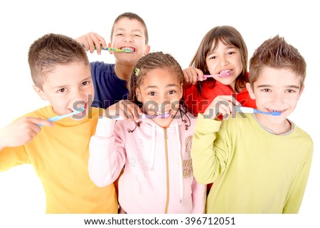 little boy brushing teeth isolated in white - stock photo