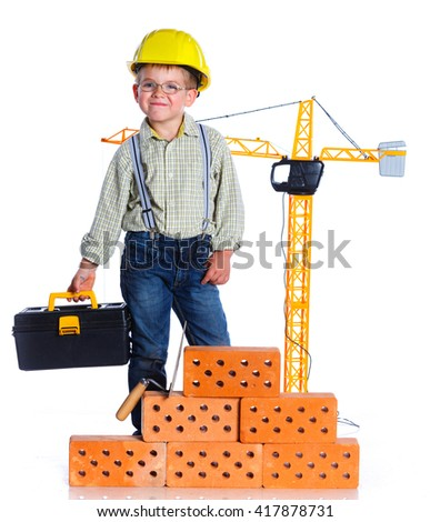 Little boy builder with helmet and tools. Isolated on the white background. - stock photo