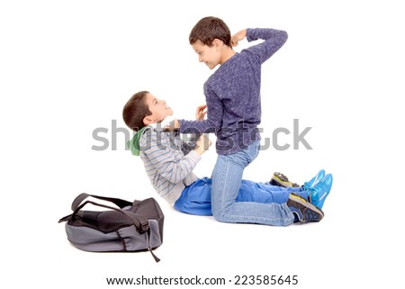 little boy bullying classmate isolated in white - stock photo