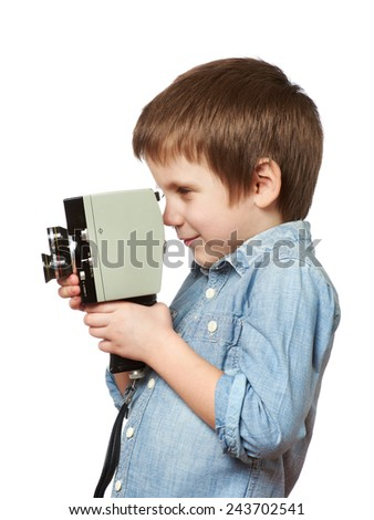 Little boy cameraman filming with retro camera isolated - stock photo