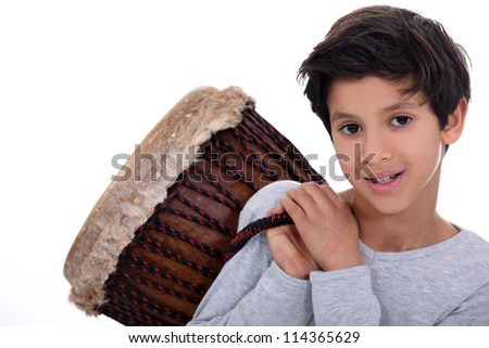 Little boy carrying bongo over shoulder - stock photo