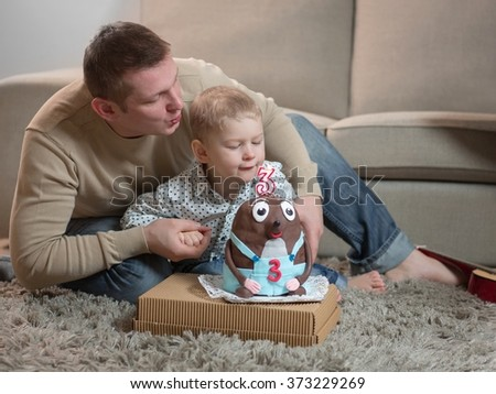 Little boy celebrating his father's third birthday,