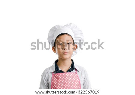 Little boy chef looking at camera isolated on white - stock photo