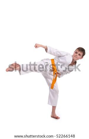 Little boy (child) practice karate isolated on white background - stock photo