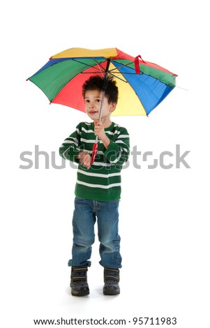 Little boy child with colorful umbrella