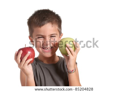 little boy choosing between a red apple and a green apple. Isolated on white - stock photo