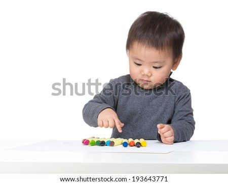 Little boy choosing color