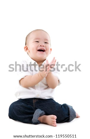 little boy clapping his hands